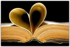 Open book with two pages folded into the shape of a heart.